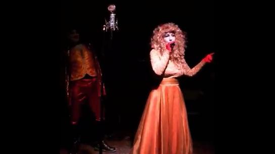 contessa playing a kazoo